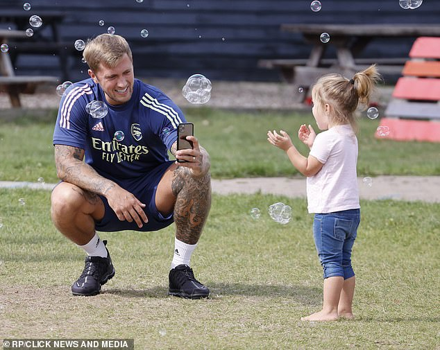 Sweet: Dan, 29, looked every inch the doting dad as he played with Mia, two