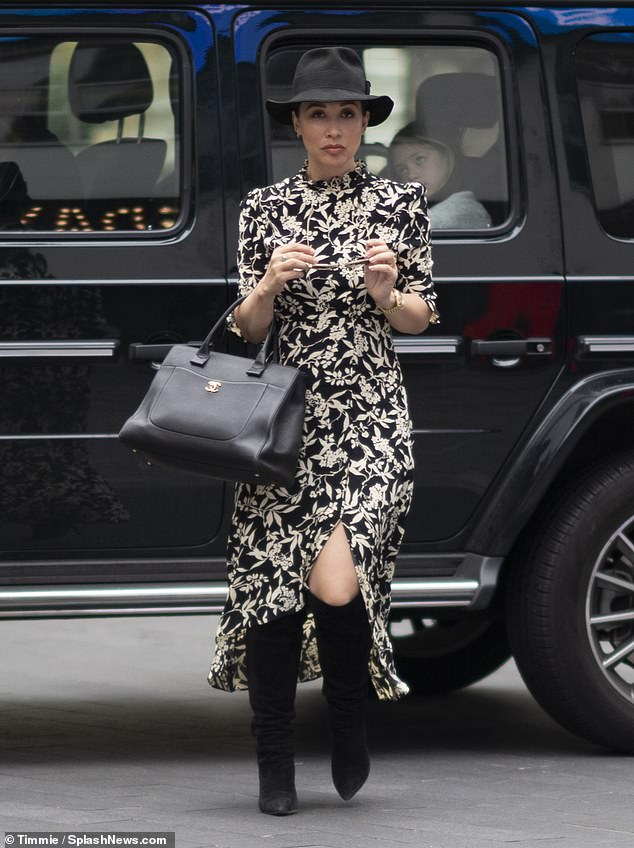Style: The former Hear'Say singer sported a black fedora hat while she also carried a matching handbag
