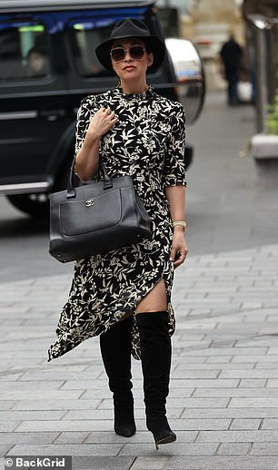 Fashion: The garment featured a high collar while Myleene added height to her frame with a pair of black boots