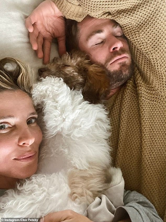 New addition: Elsa revealed they had adopted a new puppy in June, sharing of photo of herself lying alongside her husband of 10 years, Chris Hemsworth, with their puppy in between them