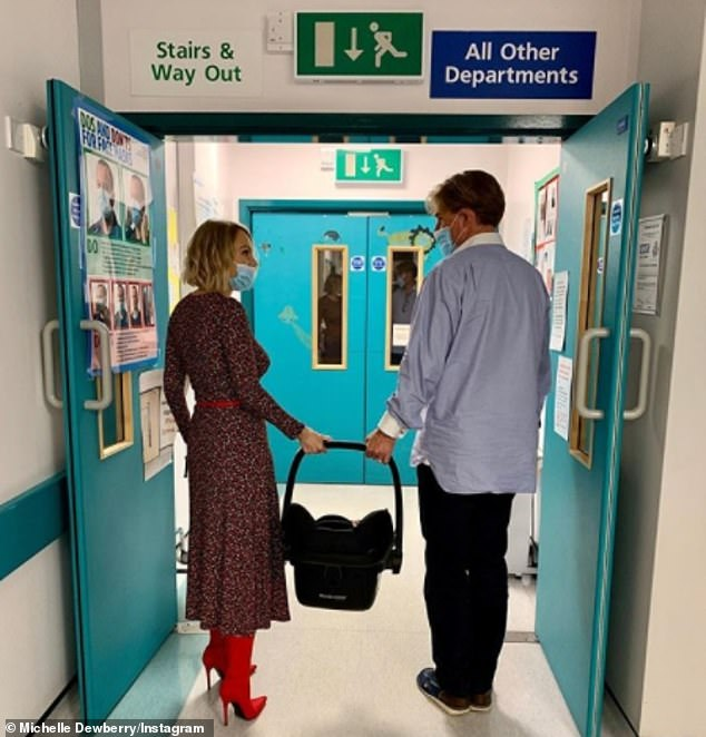 Journey:The Apprentice star Michelle Dewberry has revealed that her baby son has left neonatal intensive care unit (NICU) after six weeks (pictured with partner andex-Crystal Palace owner Simon Jordan, 52)