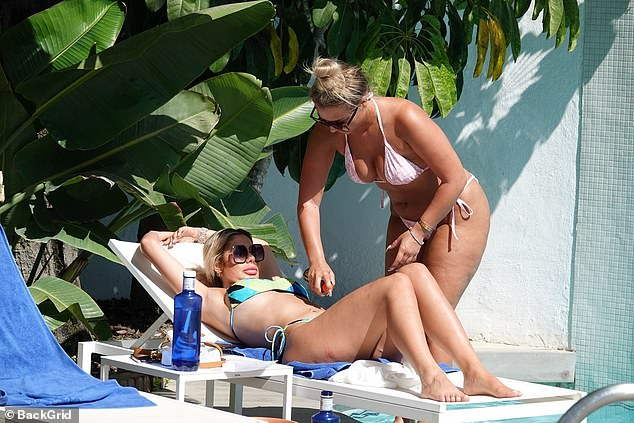 Spritz: Ensuring the Geordie beauty didn't get sunburnt, Bethan took it upon herself to spray sun tan lotion onto Chloe while she rested