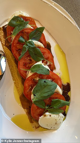 More on this story: ... as well as a plate of bruschetta with mozzarella, tomatoes and basil with balsamic vinegar and olive oil