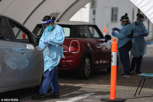 Zero cases can be maintained through quarantining international arrivals, increased coronavirus testing in all states and territories and more efficient contact tracing, the report says. Pictured: A drive through testing centre at Bondi Beach in Sydney