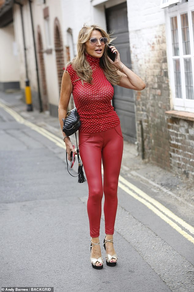 Sowing The Seeds Of Love: Lizzie Cundy flirted outrageously with a farmer when she got lost in the countryside in Hampshire wearing sexy red leather trousers on Thursday