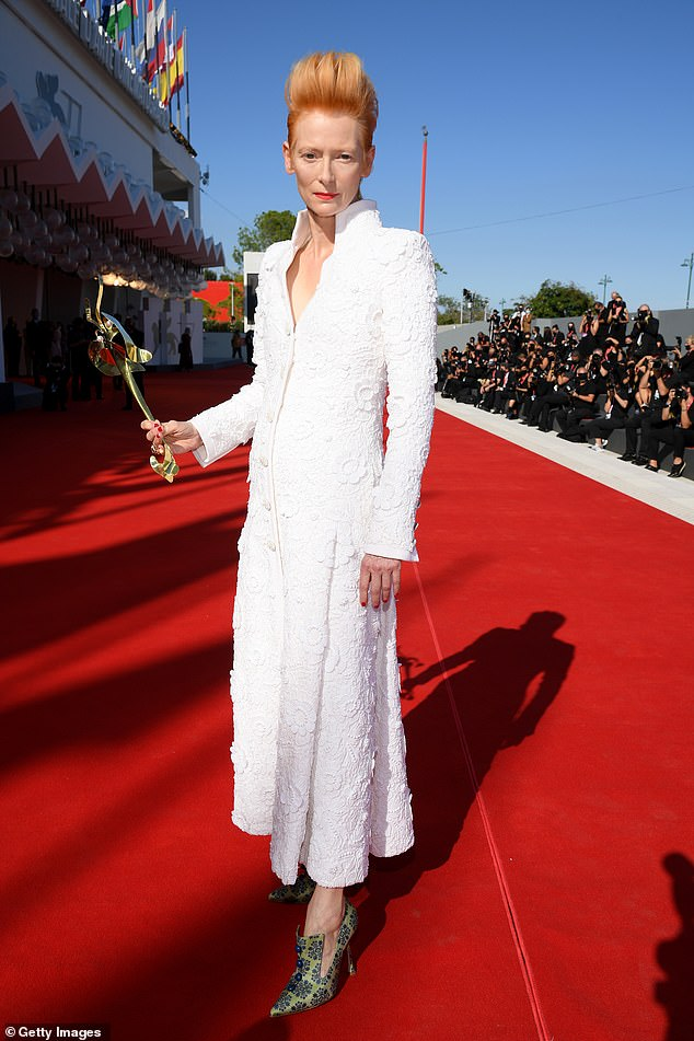 Stunning:Tilda Swinton, 59, looked every inch the film star as she walked the red carpet for the premiere of The Human Voice and Quo Vadis, Aida? in Venice on Thursday