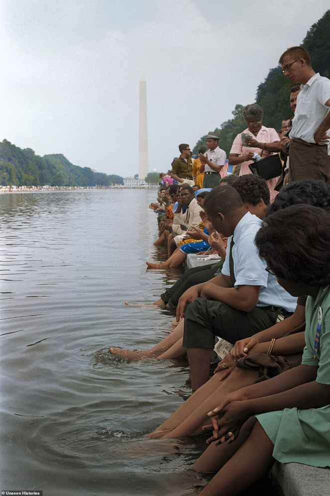 During the protests, hundreds of demonstrators gathered around the reflecting pool and dipped their feet in the water, in front of the Lincoln Memorial where Martin Luther King Jr gave his iconic speech