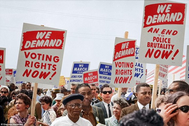 The demonstrators, of all racial backgrounds and ages, which were involved in the March on Washington for Jobs and Freedom held thousands of signs calling for equal voting rights and jobs for all with decent pay