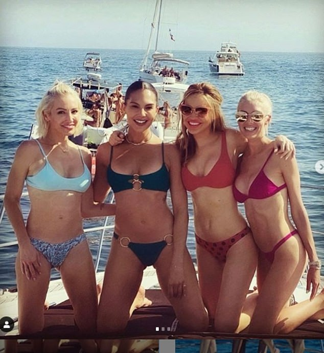Bathing beauty: Chrishell, in the red bikini, is seen with some of her cast mates on a boat