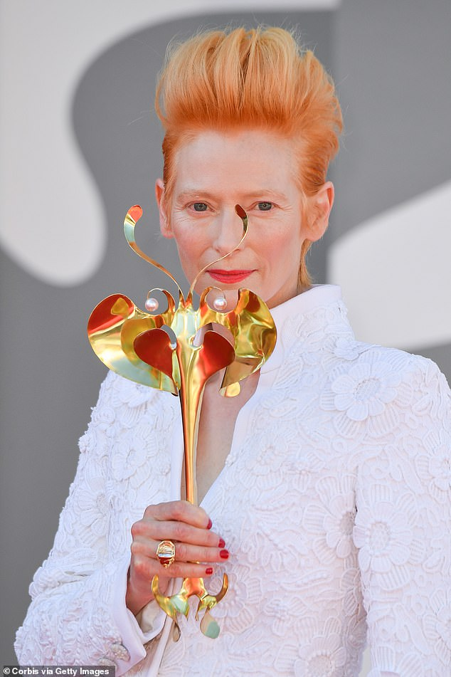 Radiant: Tilda added to her look for the premiere by wearing a striking red lip