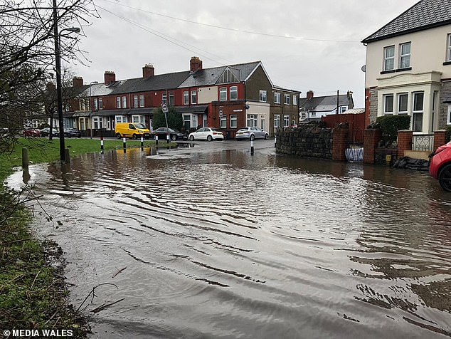 Flooding at Ely Bridge in Cardiff after Storm Jorge battered Wales in an onslaught of rain