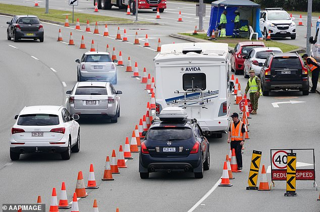 Scott Morrison will push to end state border closures at the National Cabinet meeting on Friday. Pictured: Motorists attempt to cross into Queensland before the state shut to NSW on August 8