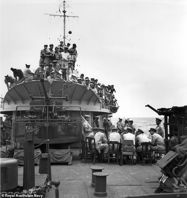Surrender Ceremony aboard the HMAS Burdekin (Australia) on September 8, 1945 conducted between Major General EJ Milford, General Officer Commanding 7th Australian Division, and Vice Admiral Mitchishi Kamada of Japan