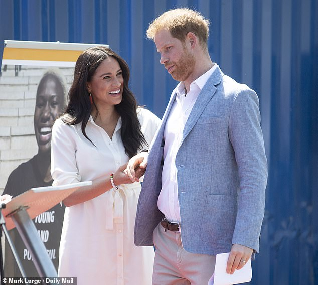 The Duke and Duchess of Sussex pictured visiting a Tembisa township in South Africa