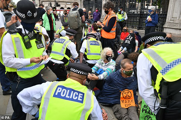 Another group of protesters staging a sit down protest at the Carriage Gates entrance to the Houses of Parliament