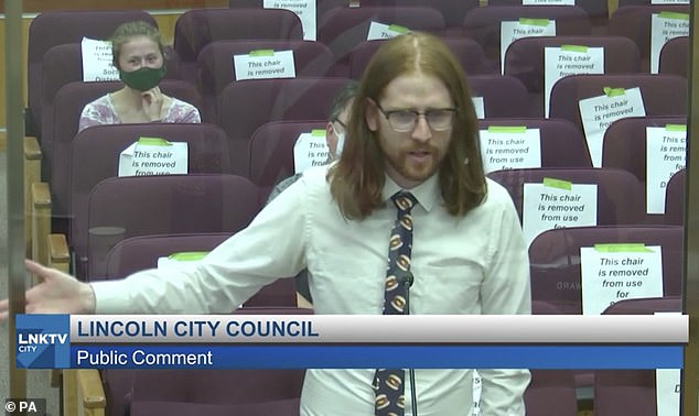 Chemical engineer Ander Christensen (pictured) issued a heartfelt plea for his city council to stop using the term 'boneless chicken wings' because the popular menu item doesn't actually come from the wing of the bird