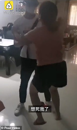 The parent is seen jumping and dancing with joy