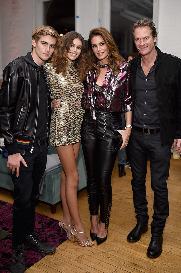 Beautiful family:Along with Kaia, Rande and Cindy are also parents to older son Presley, 21 (The Gerbers in 2017)