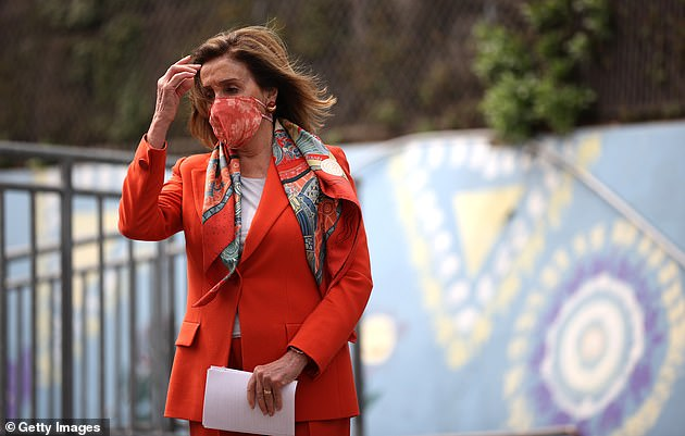Speaker Pelosi, wearing a face mask, arrives at a press conference in San Francisco to address footage of her getting a wash and blow dry at a salon while maskless