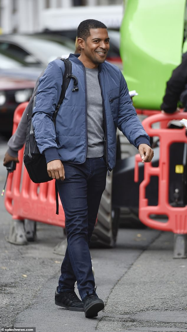 Back on set:Former Doctor Who star Noel was also in high spirits as he arrived on the set, opting for a casual blue jacket and matching chino trousers