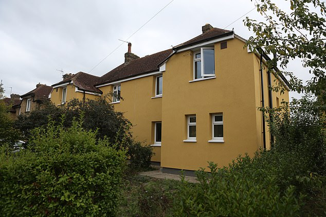 The council has said that to paint over the yellow risks 'invalidating the Council's warranty' on external insulation that was also installed as part of the scheme