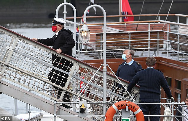 Pictured: Crew on board the Paddle steamer Waverley as it departs from Glasgow for a cruise along the River Clyde on August 22