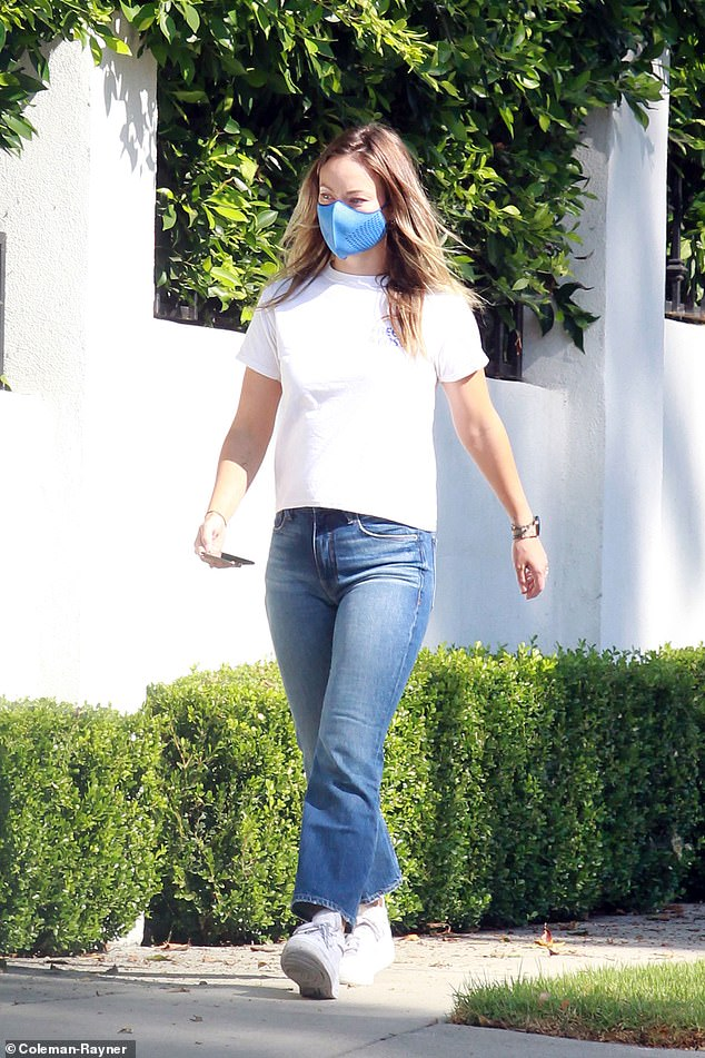 Casual cool: Wilde wore a Free & Easy T-shirt, blue jeans, and comfortable trainers