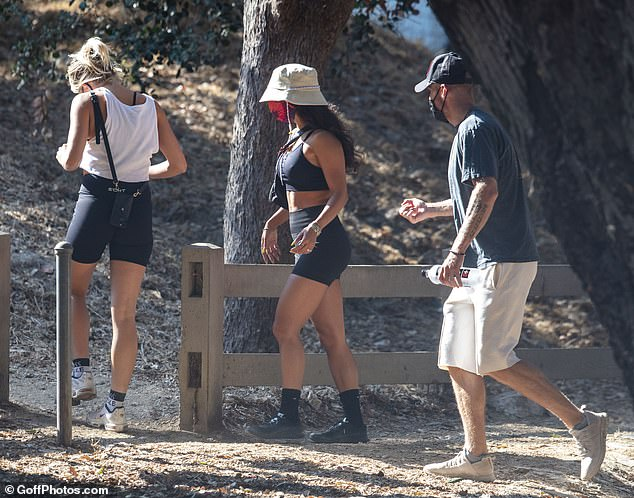 Enjoying themselves: The trio stayed close together as they navigated the trails