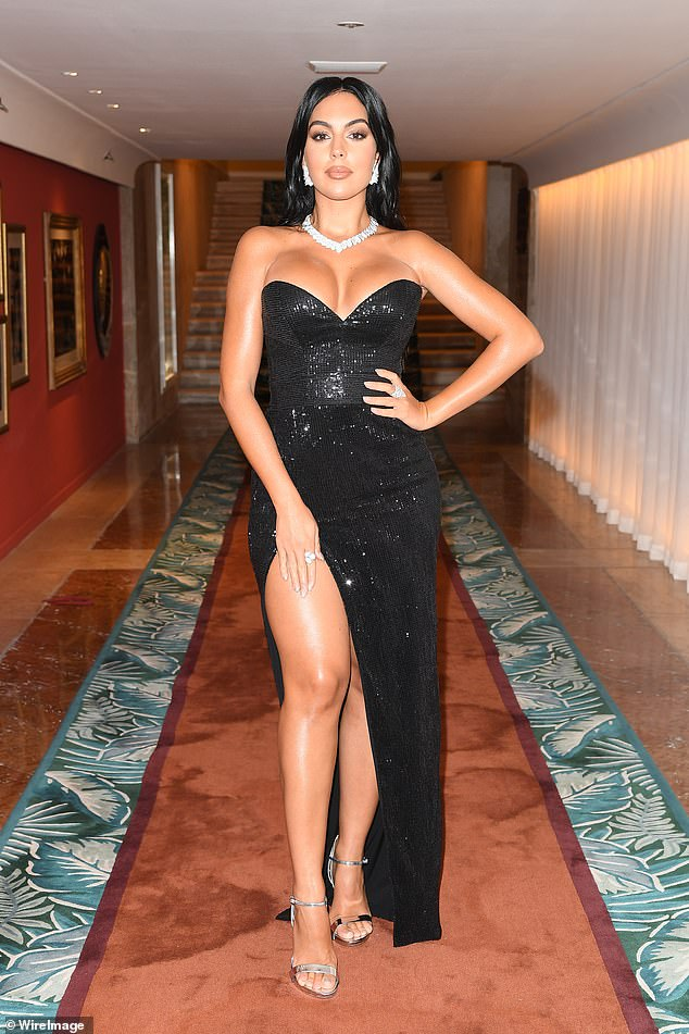 Wow! The model, 26, put her more than ample assets on display in a skintight glitzy black gown, which highlighted her sizzling curvaceous frame to perfection