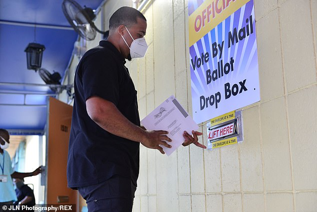 Voters drop their ballot at the drop box at Broward County Supervisor of Election Headquarters in Lauderhill, Florida, U.S., on Tuesday, Aug. 18, 2020