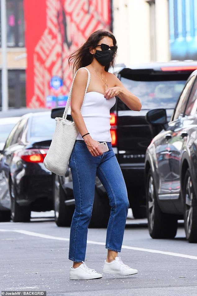 Hitting her stride: The actress strode comfortably through the bustling big city in her pristine white sneakers
