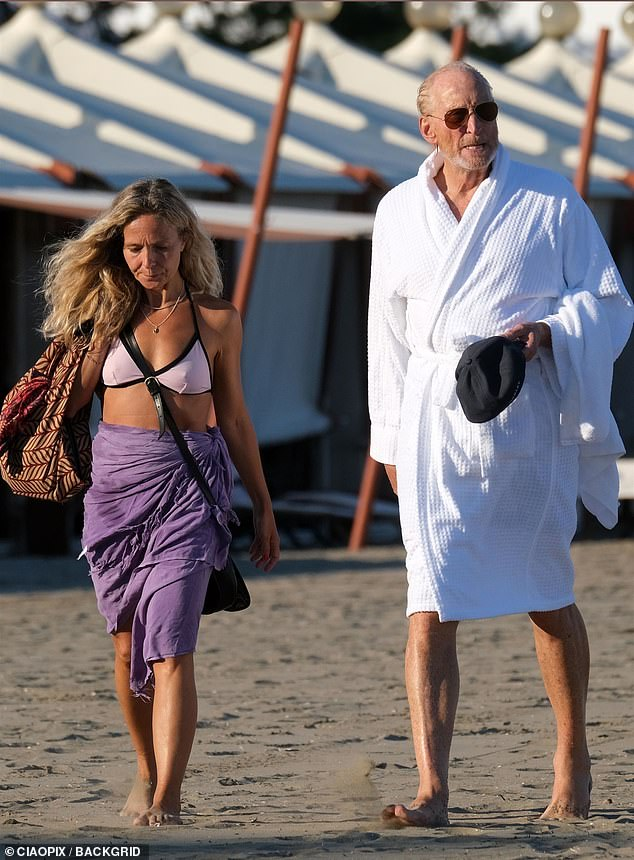 On a break: Charles took a break from his film promotional duties to enjoy a day at the beach with his female companion