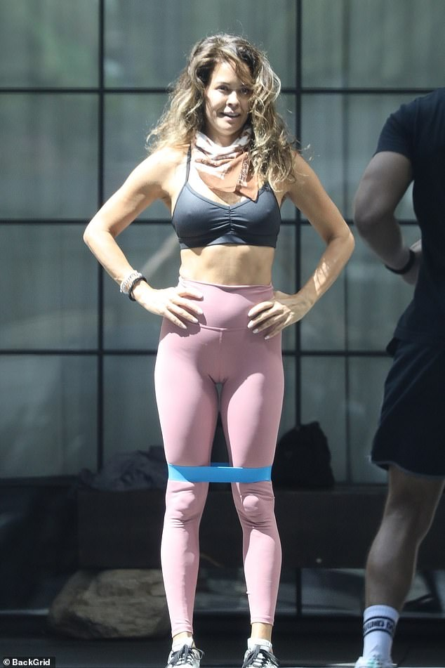 Abs: While sporting a pair of skintight pink leggings, the 48-year-old fitness guru could be seen participating in a high-impact training session with her 18-year-old Sierra