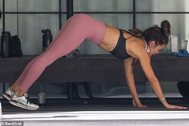 Hard work: The former Dancing With the Stars host added to her abdominal and full-body exercises by doing some grueling planks