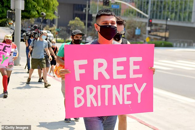 #FreeBritney: Many fans have been using online petitions, social media posts and even some in-person protests to call for the Womanizer crooner to be released from her conservatorship; Supporters of Britney Spears pictured on August 19