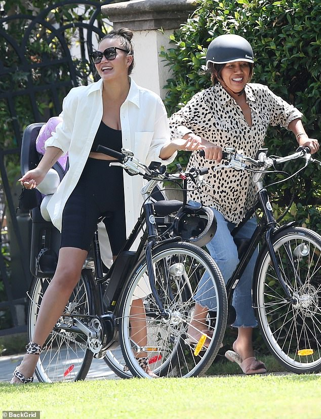Hot ride:Chrissy Teigen enjoyed a girls day on Thursday heading out for a bike ride in Los Angeles with her mom and daughter Luna, four