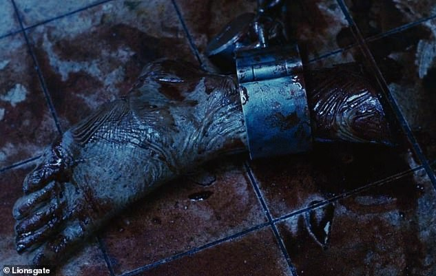 I saw it first! Saw is a 2004 torture porn horror film in which a man has to slice off his own foot in order to escape a trap, set by a serial killer