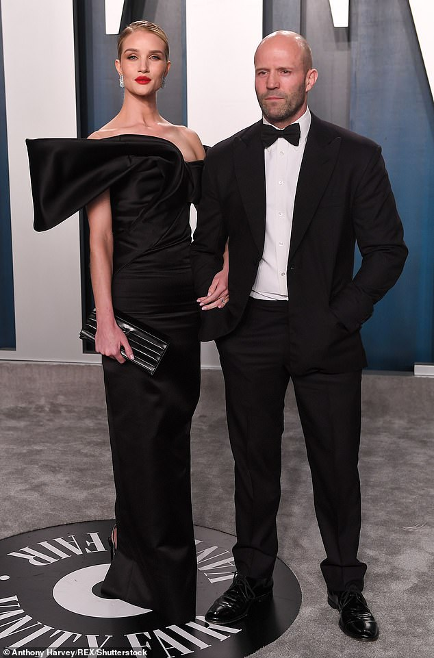 A-lister: Statham posed with stunning wife Rosie Huntington-Whiteley at the Oscars earlier this year