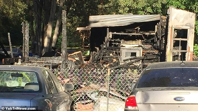 A house fire in Benton City, Washington, killed the wife and three children of a firefighter who was battling a wildfire 200 miles away. Pictured: The burnt home atGreen Acres Mobile Home and RV Park