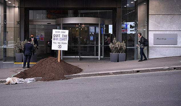 Extinction Rebellion activists dumped manure outside a number of News Corp offices to protest against the media giant's coverage of climate change (pictured, manure dumped outside of the News Corp office in Sydney on Friday)