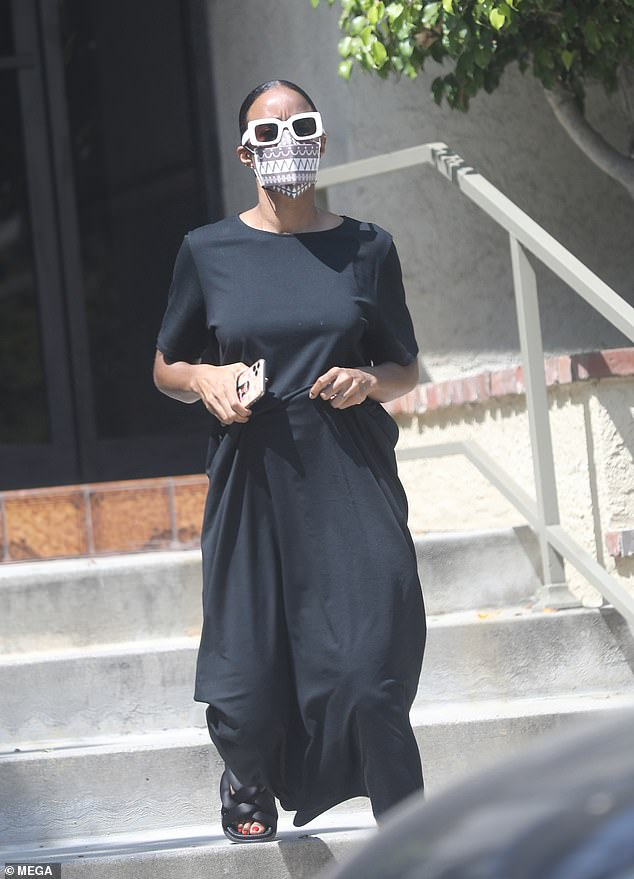 Kelly Rowland looks nearly unrecognizable in sunglasses, mask and flowy dress during errand run