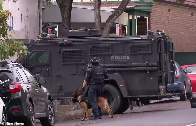 Tactical police (pictured)discovered Difloriano with a shotgun wound to his head in a nearby house on Victoria Street