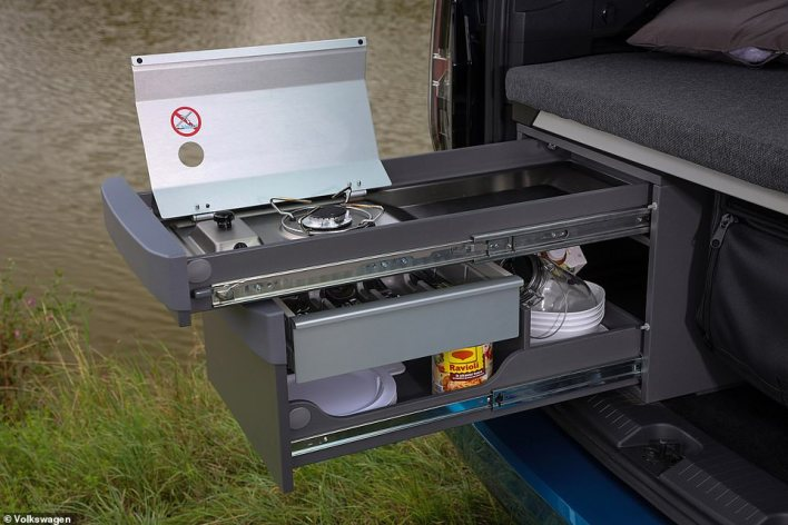 There's a mico kitchen which slides on rails from a compartment slotted into the boot, providing a cooking solution from the most compact campervan design
