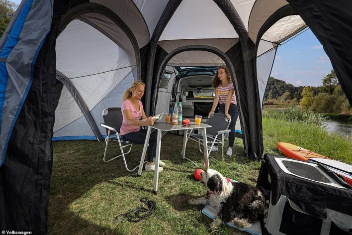 An additional tent, which fits to the boot section of the Caddy California, means you can take another two people (or more, looking at these images) on tour with you