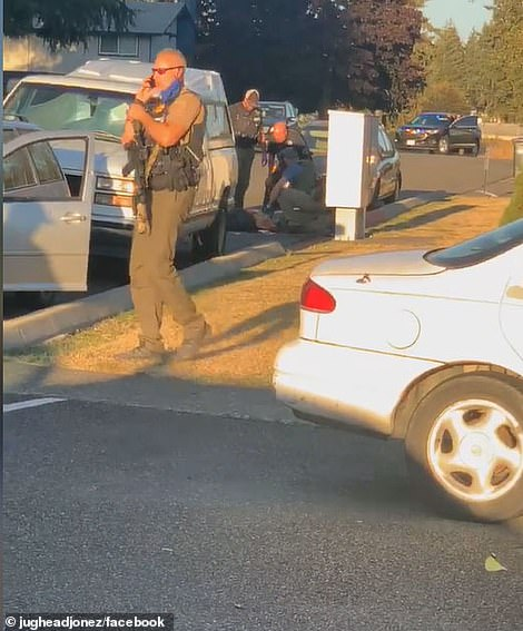 Officers are seen attempting in vain to render life-saving aid after the confrontation around 7pm on Thursday outside of Seattle that left Reinoehl dead