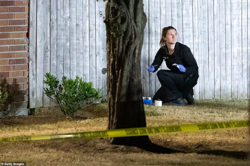 Investigators work the scene at Tanglewilde Terrace where law enforcement shot and killed a man who is reportedly Michael Forest Reinoehl last night in Lacey, Washington