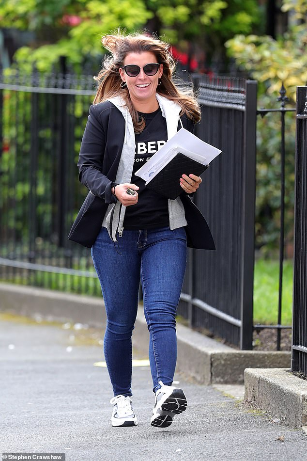 Cozy: Coleen completed the look by shrugging off a black blazer over a gray hoodie, while she decided to forgo bringing a bag to keep her belongings