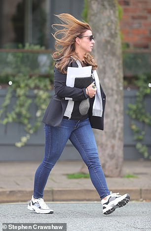 Choice: Coleen could be seen carrying a grey face mask in her hands rather than wearing it as she walked down the street