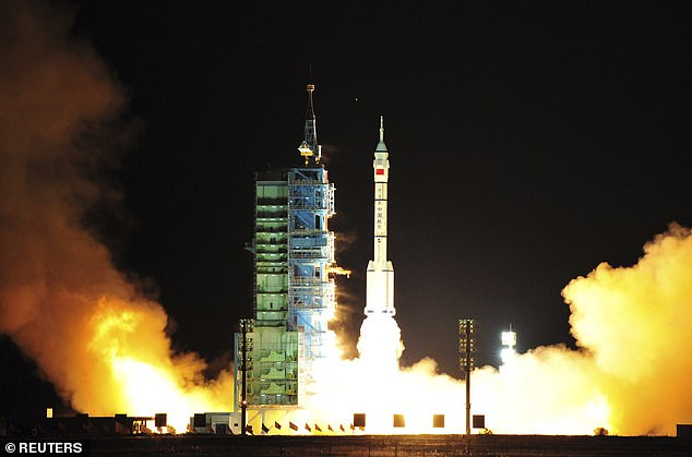 A Long March-2F carrier delivered the spacecraft into orbit from Jiuquan Satellite Launch Centre in north-western Chinese region Inner Mongolia, reported state media Xinhua. The file picture shows a modified model of the Long March CZ-2F rocket carrying the unmanned spacecraft Shenzhou 8 taking off from northwest China on November 1, 2011
