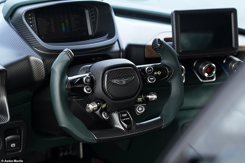 The F1-style sawn-off steering wheel is also from the Vulcan track car and all the switch gear is finely-crafted aluminium and titanium